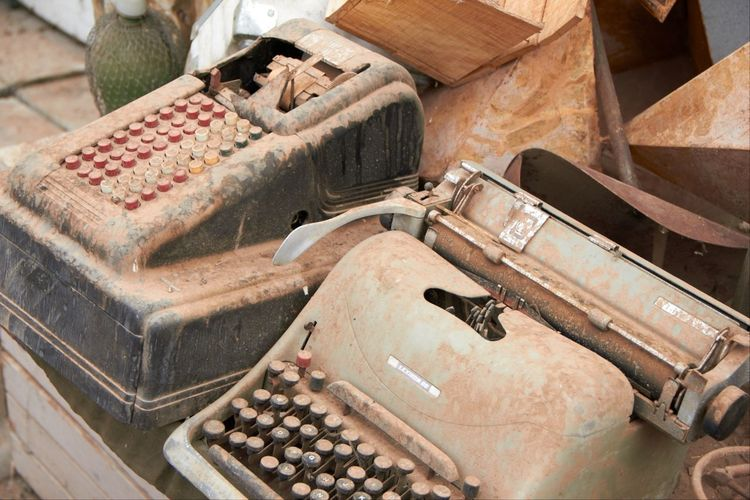 High angle view of abandoned typewriters