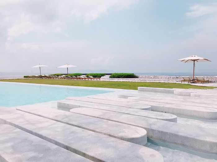Scenic view of infinity pool against sky