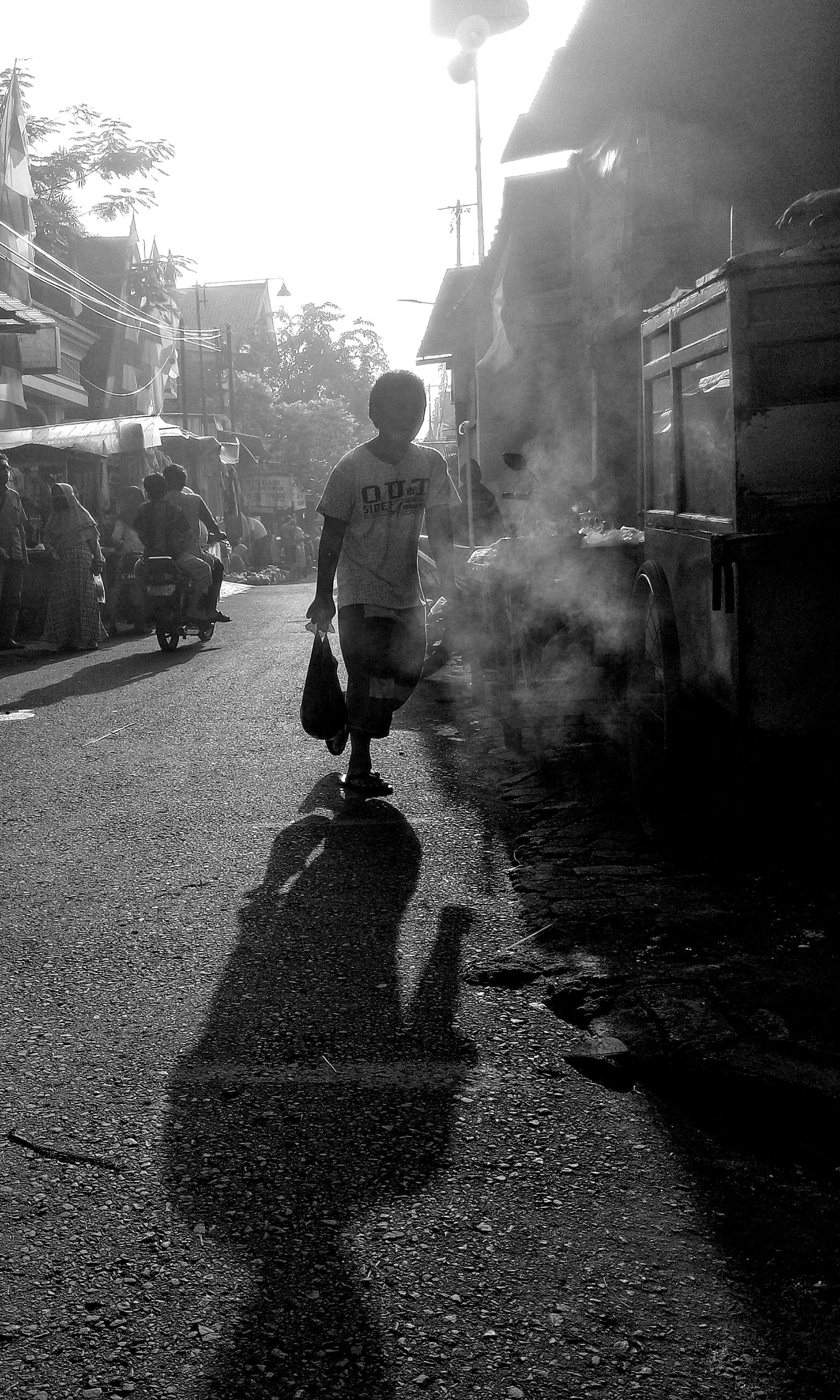 black, transportation, black and white, city, street, architecture, monochrome, mode of transportation, darkness, road, monochrome photography, building exterior, one person, land vehicle, white, sunlight, men, nature, built structure, motor vehicle, car, full length, sky, day, walking, adult, infrastructure, lifestyles, rear view, city life, city street, shadow, outdoors, motion, light, smoke, vehicle
