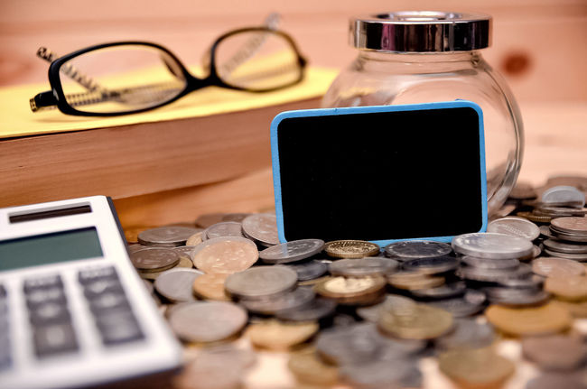 Blank mini chalkboard with blurred background of books, calculator, reading glass and empty jar. Copy Space Financial Planning Financial Service Financial Finance Conceptual Art Bank Bitcoin Bitcoin Mining Close-up Coin Communication Day Eyeglasses  Finance Indoors  Information Medium Large Group Of Objects Mobile Phone No People Portable Information Device Smart Phone Table Technology Touch Screen Wireless Technology
