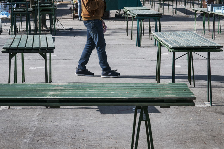 Low section of man standing on bench