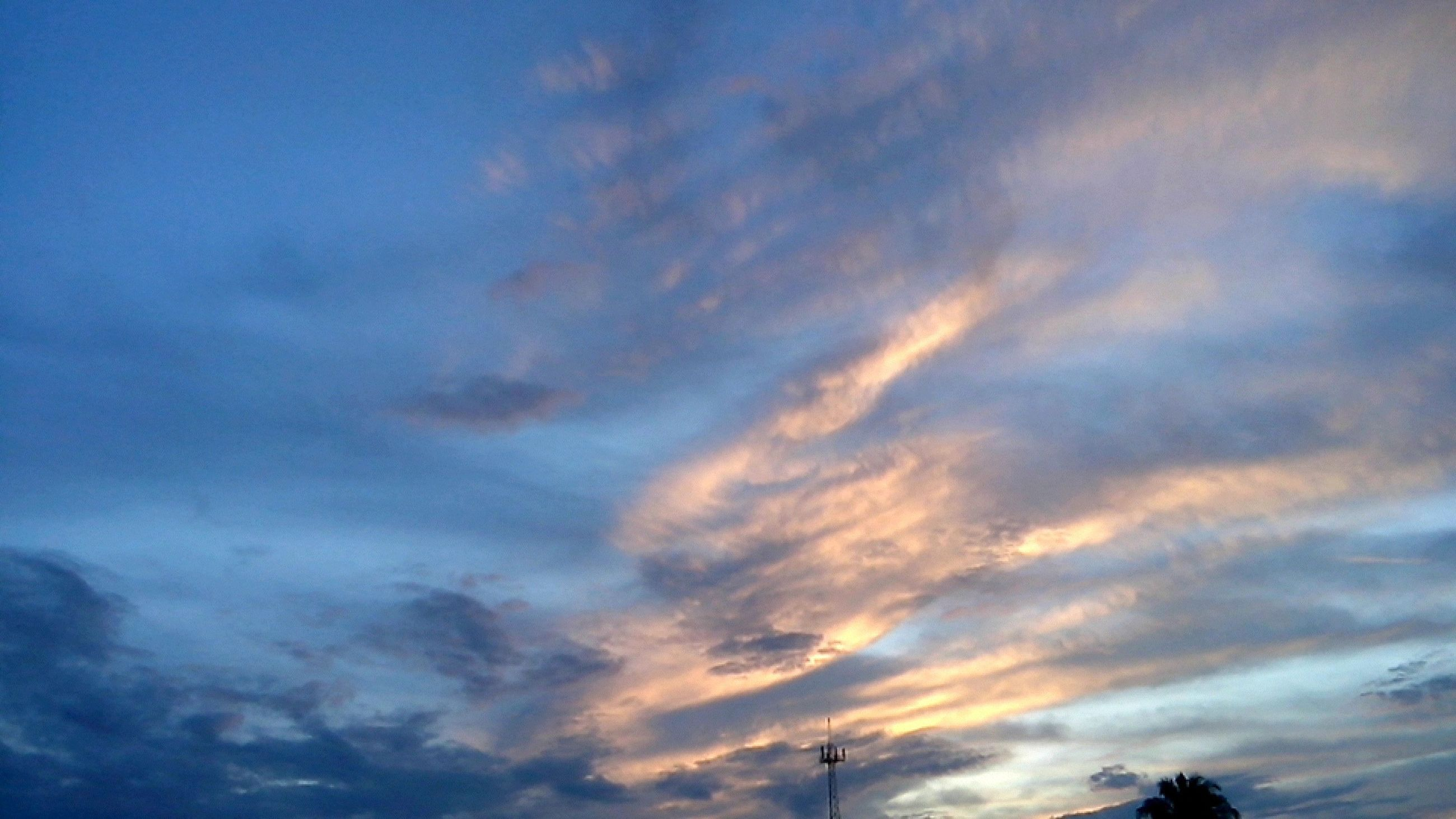 low angle view, sky, cloud - sky, cloudy, beauty in nature, tranquility, scenics, nature, silhouette, tranquil scene, cloud, sunset, blue, cloudscape, idyllic, dramatic sky, weather, outdoors, no people, overcast