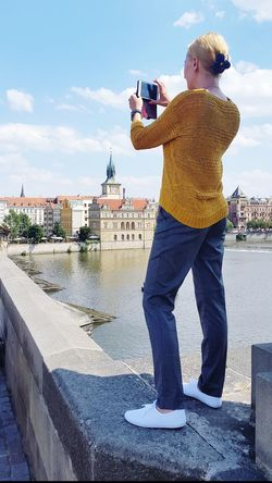 Standing Casual Clothing Photography Themes Full Length Photographing Technology Standing On A Bridge Standing On The Edge Trying To Take A Photo ✌ Human Back One Woman Only One Person Backfacing Photographer Photographer In Action The Week On EyeEm Prague Czech Republic Prague Bridge Streetphotography Spontaneous Moments Funny Moments Vacations Travel Vacation Photos   EyeEmNewHere Your Ticket To Europe Breathing Space Be. Ready. Go Higher Stories From The City