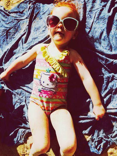 Monochrome Eva sunbathes in mama's sunglasses