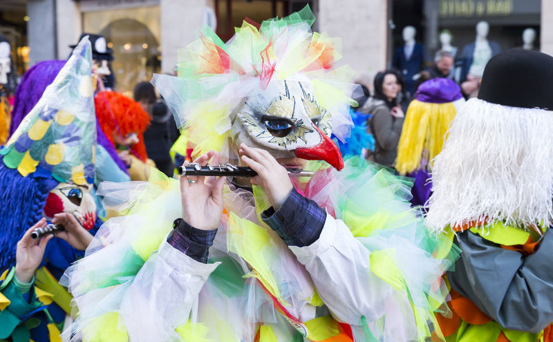 Eisengasse, Basel, Switzerland - March 7, 2017. Closeup of a carnival participant in a bird like costume playing piccolo. Basel Event Tourist Attraction  Bird Carnival Celebration Close-up Colorful Costume Creative Culture Group Of People Mask - Disguise Musical Instrument Outdoors Parade Piccolo Playing Real People Shrove Tuesday Streetphotography Swiss Switzerland Tradition Traditional Festival