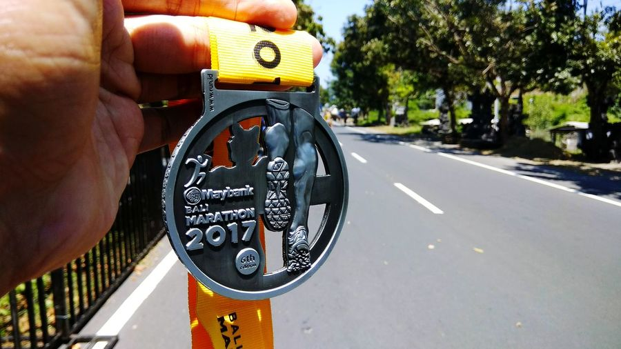 the medal :) _ Finisher Medal Maybank Bali Marathon Bali Marathon Human Hand Close-up Runners View Running Race Lomba Lari Road Runners Bali Marathon 2017 Run Run Run Medal Finishers Medallion