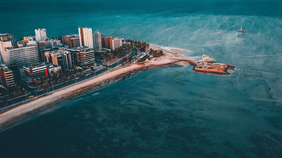 Ocean and city Water High Angle View Sea Nature No People Architecture Aerial View Beach Day Land City Built Structure Beauty In Nature Travel Transportation Outdoors Waterfront Tranquil Scene Building Exterior Bay