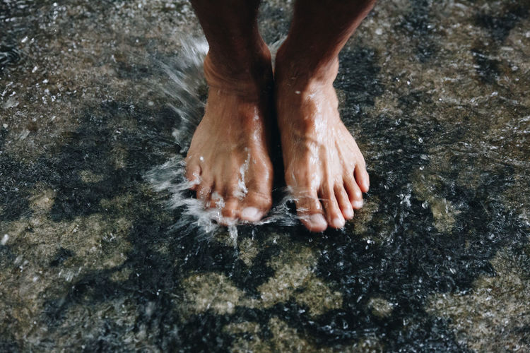 Rain barefoot Water Low Section Human Body Part Body Part Human Leg One Person Nature Real People Wet Lifestyles Land Human Foot Day Standing High Angle View Leisure Activity Outdoors Human Limb Foot