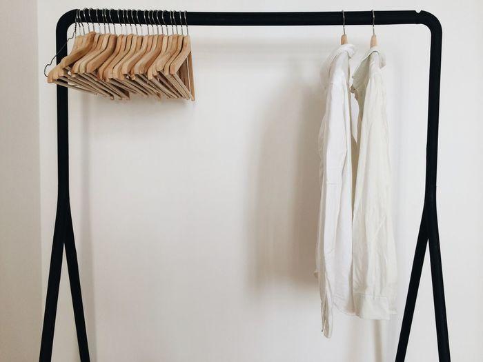 Empty coathangers on rack over white background