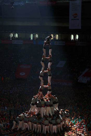 Human Towers Castellers Text Communication Western Script Illuminated Indoors  No People Decoration