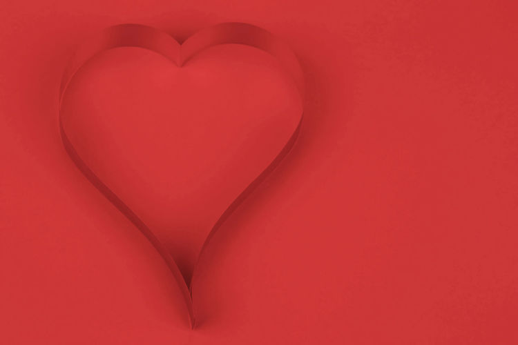 Close-up of heart shape on red paper