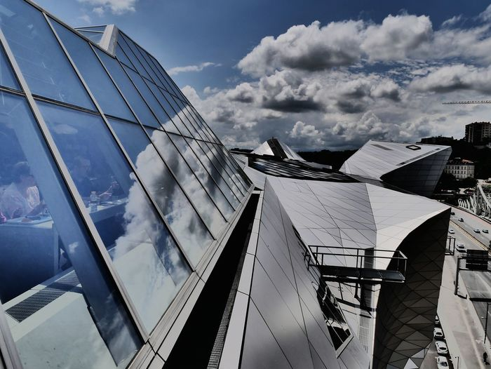 Architecture Building City City Life Cloud Cloud - Sky Dark Clouds Above Glassfront Impressive View Lyon France Metallic Metallic Structure Modern Musée Des Confluences Outdoors People At Lunch Sky Threatening Sky