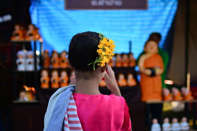 Rear View Of Girl Wearing Flowers On Head