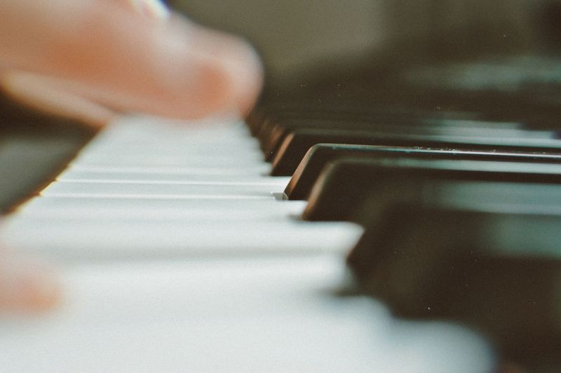 Blurred motion of person playing piano