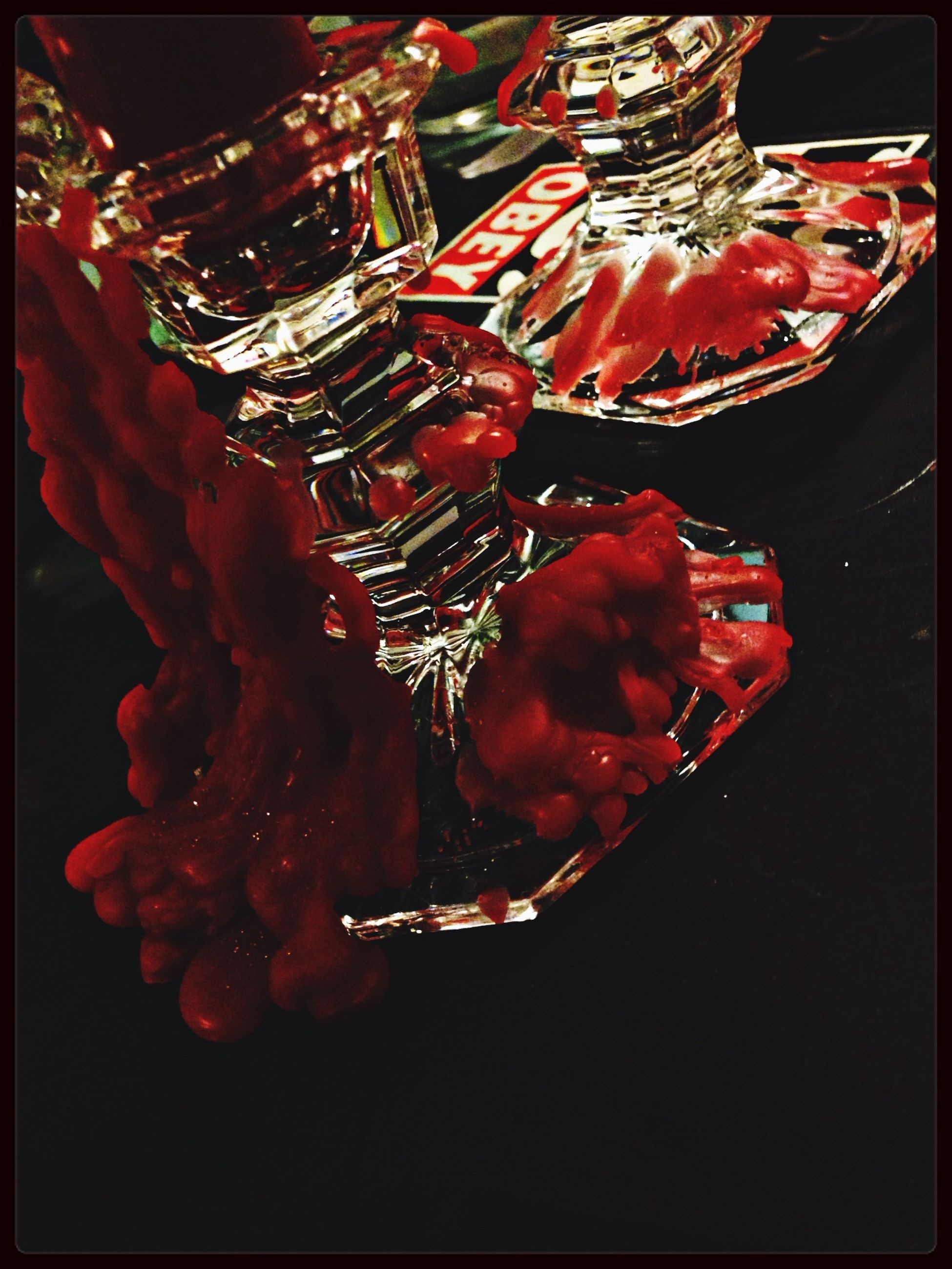 red, transfer print, auto post production filter, close-up, studio shot, indoors, still life, no people, freshness, night, food and drink, low angle view, black background, flower, illuminated, single object, decoration, high angle view, orange color