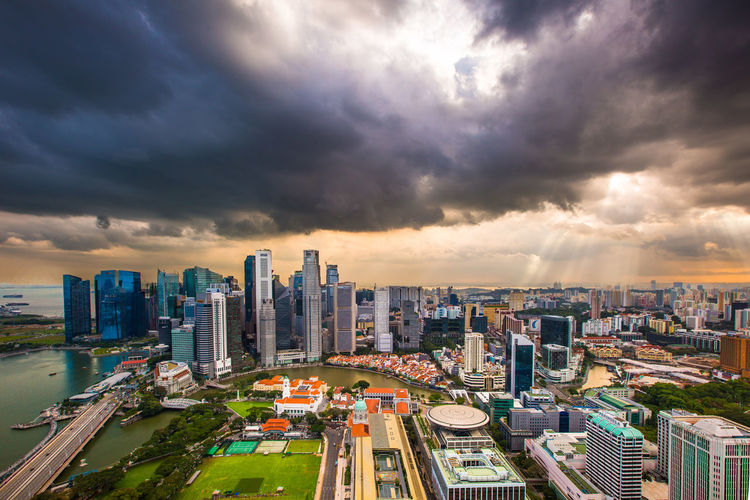 @sgrobert / robertchai.com | When Sunlight Trickled Down Above The Dark Clouds And Lit Up A Part Of The Singapore City Skyline | Singapore City Center Skyline, Singapore Financial District  Outdoors Modern Tower Landscape Crowded City Life Crowd Residential District Skyscraper Nature High Angle View Office Building Exterior Cityscape Building Sky Cloud - Sky Built Structure Building Exterior Sunset Glow City Colourful Singapore Sunset Skyline Travel Destinations Epic Shot Photography Best EyeEm Shot EyeEm Gallery EyeEm Selects EyeEm Best Shots Buildings & Sky Sunset_collection Sunset Sunrays_penetrating_clouds Sunrays Gloomy Weather Cityscapes_collection Architecture_collection Architecture Singapore City View Singapore City Singapore View Singapore Overcast Ominous