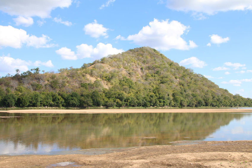 Ruvuma River, border between Tanzania and Mozambique Architecture Beauty In Nature Cloud - Sky Day Idyllic Landscape Nature No People Outdoors Reflections In The Water Ruvuma River Scenics Sky Tranquil Scene Tranquility Tree Water