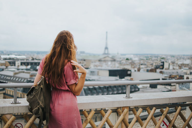 Adult Alone Let's Go. Together. Millenials NOMAD Paris Romantic Solo Traveler! Built Structure Cityscape Europe Focus On Foreground Hair Leisure Activity Long Hair Looking At View On The Road One Person Railing Real People Solo Travel Standing Three Quarter Length Travel Destinations Young Adult