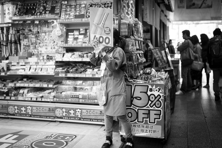 400 Retail  Real People One Person Lifestyles Incidental People Full Length Adult Store Women Text Standing Leisure Activity Shopping Men Choice Market Food And Drink Architecture Focus On Foreground Consumerism Retail Display 400 Shop Shopping Japan Japan Photography Canon Canonphotography Monochrome Blackandwhite Black And White Black & White The Traveler - 2019 EyeEm Awards The Street Photographer - 2019 EyeEm Awards