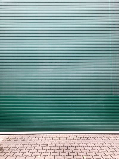 Urban Garage Door Garage Pattern No People Shutter Day Safety Closed Wall - Building Feature Backgrounds Metal Full Frame Textured  Architecture Security Communication Protection Green Color Text Outdoors Built Structure Blue