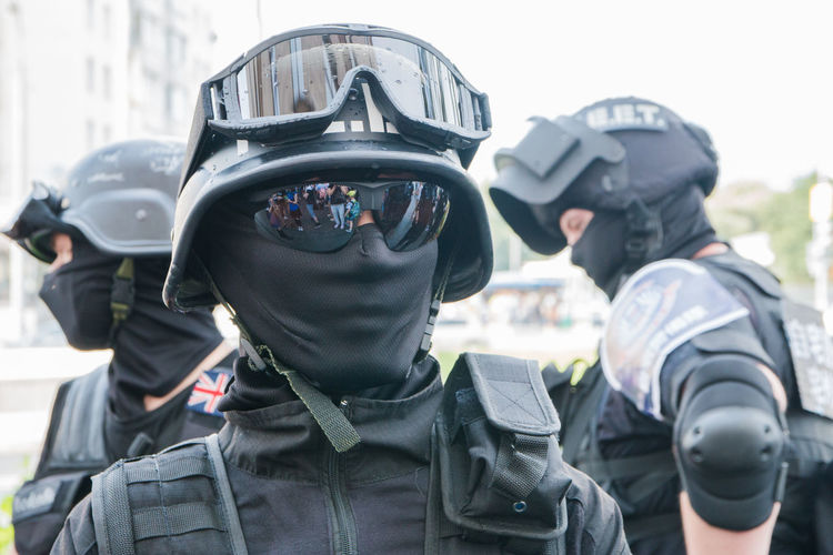 Cosplay Clothing Crash Helmet Day Focus On Foreground Government Headshot Headwear Helmet Law Men Military Obscured Face Outdoors People Police Force Portrait Protection Protective Workwear Real People Safety Security Two People Uniform