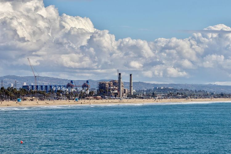 Huntington Beach coastline Aes Power Plant Desalinization Sky Cloud - Sky Water Sea Architecture Building Exterior Built Structure Nature Land Waterfront Beach Day Scenics - Nature Beauty In Nature Mountain Outdoors Building Tranquil Scene Huntington Beach Orange County Southern California