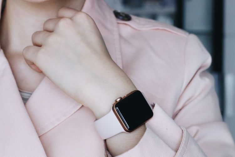 Midsection Of Businesswoman Wearing Smart Watch