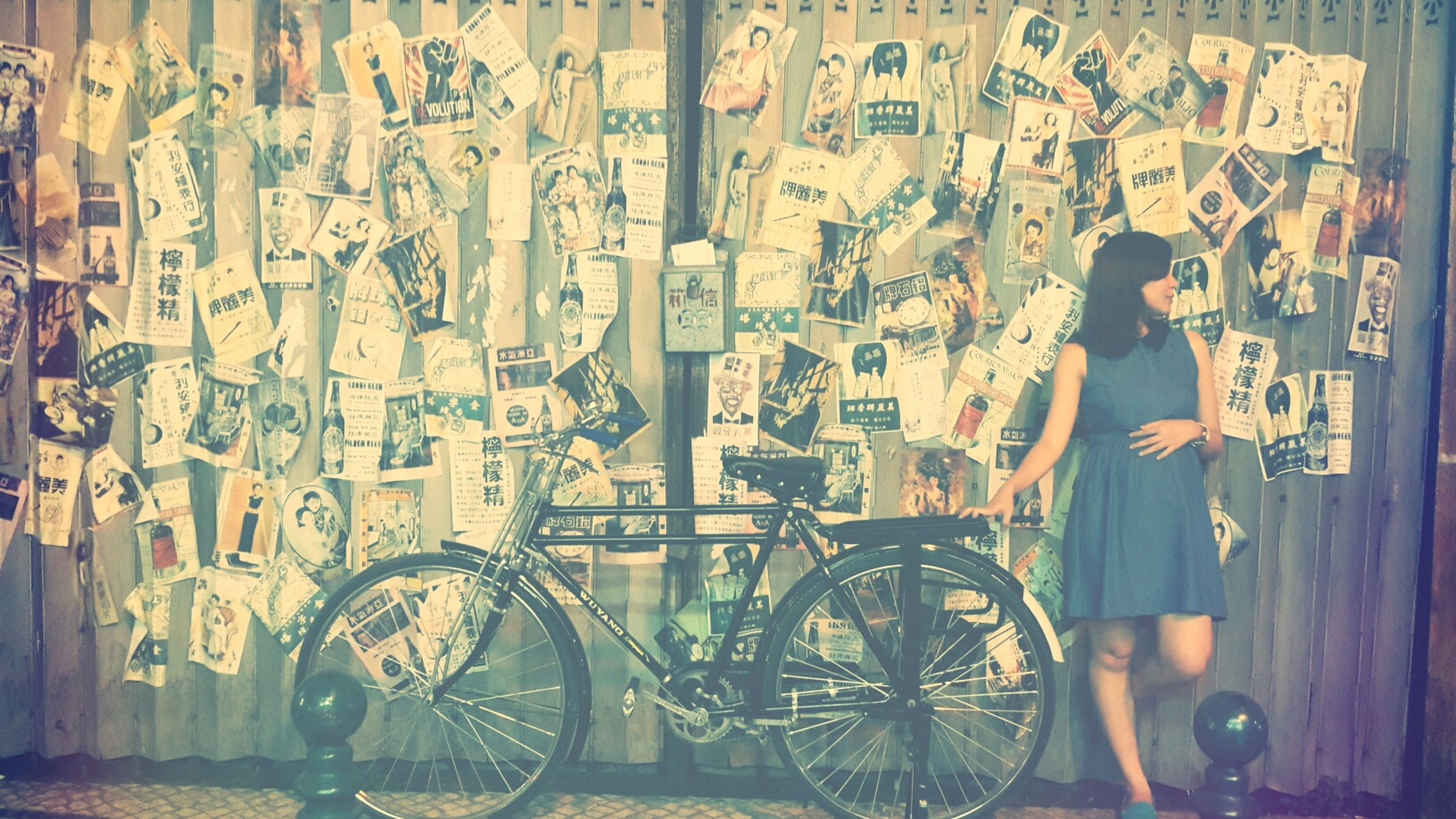 bicycle, wall - building feature, graffiti, built structure, architecture, transportation, wall, text, stationary, building exterior, metal, mode of transport, land vehicle, indoors, day, art, parking, gate, art and craft