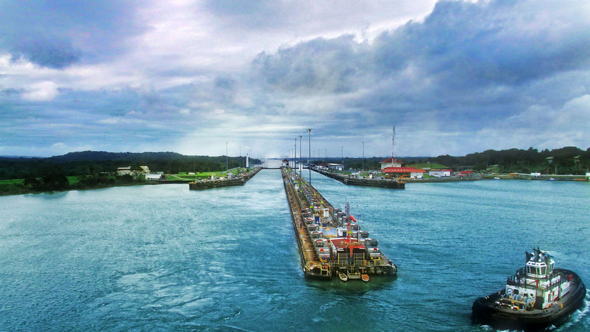Panama Canal - Entrance Shot #panama #Panama Canal Architecture Beauty In Nature Boat Photography Cloud - Sky Day Harbor Nature Nautical Vessel No People Outdoors Panama Canal Panamá Passage River Sailing Scenics Sky Transportation Water Waterfront