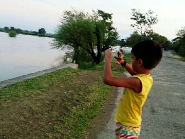 Elementary Age Reflection Photography Themes Innocence Hobbies Casual Clothing Childhood Holding Lake The Young Photographer