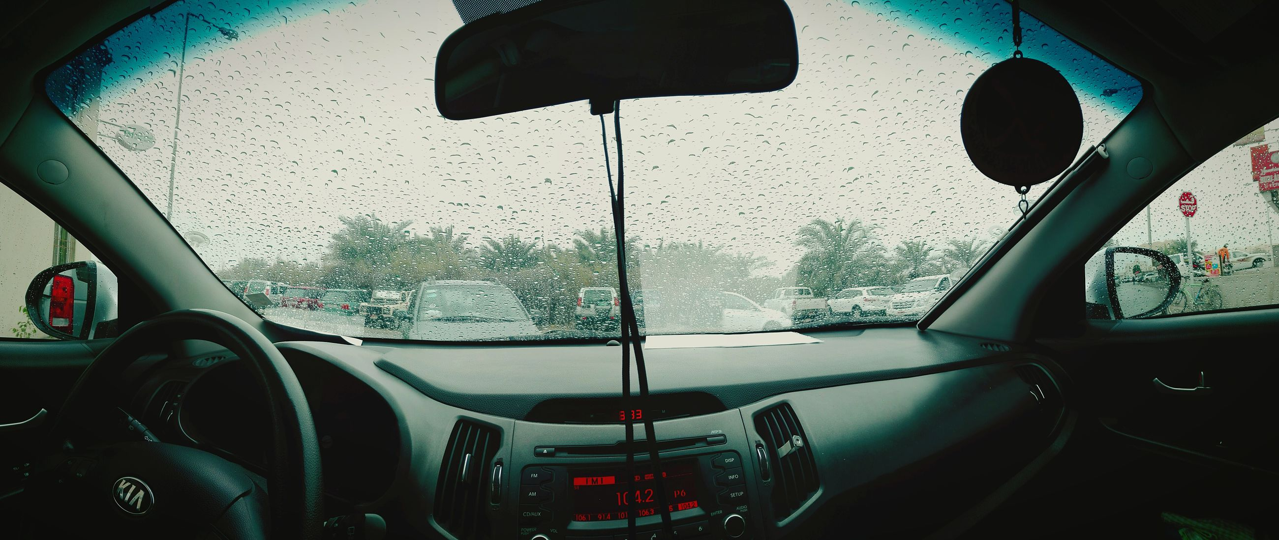 car, vehicle interior, glass - material, transparent, transportation, mode of transport, window, car interior, windshield, land vehicle, wet, close-up, no people, dashboard, windscreen, steering wheel, day, water, indoors