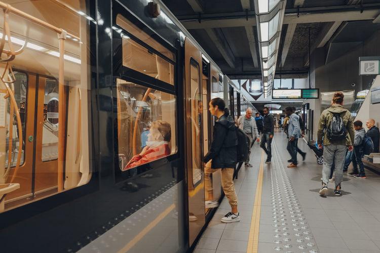 People on train at railroad station platform