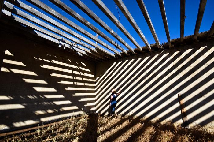 No Way Out Colorado EyeEmNewHere Ranch Stripes Sunlight Woman Abandoned Beams Corner Geometric Shape Girl Illusion One Person Pattern Rurex Shadow Stripes Pattern Sunlight Sunlight And Shadow Walls