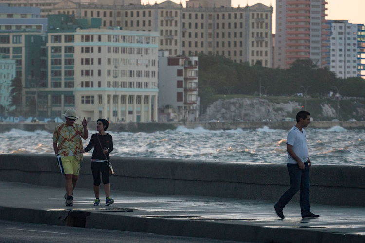 Malecon, November 2016 Before Sunset Coastline Couple Architecture Building Exterior Built Structure Casual Clothing City Day Evening Full Length Lifestyles Malecón, La Habana Outdoors People Real People Sea Sky Splashing Waves Standing Togetherness Water Young Adult