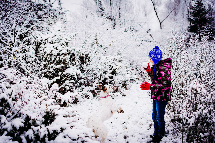 Winter Cold Temperature Snow One Person Real People Warm Clothing Lifestyles Clothing Leisure Activity Standing Child Day Nature Hat Girls Childhood Women Land Extreme Weather Outdoors Hood - Clothing Innocence