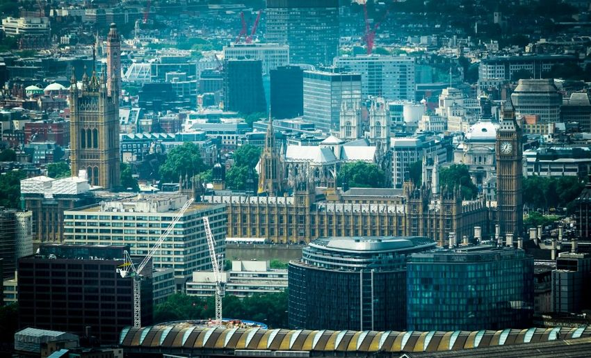 High angle view of big ben amidst buildings in city