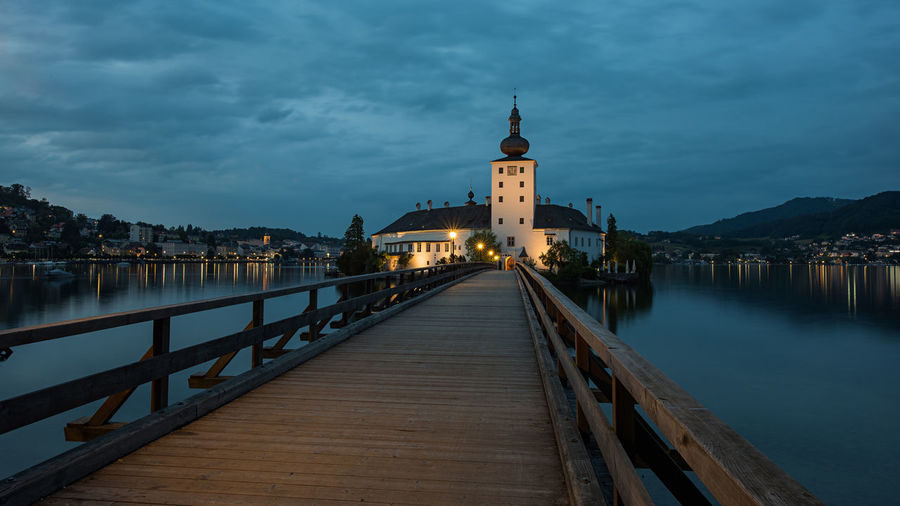 Salzkammergut, Austria Schloss Ort Architecture Belief Bridge Bridge - Man Made Structure Building Building Exterior Built Structure Canal Cloud - Sky Connection Direction Illuminated Nature No People Outdoors Place Of Worship Religion Sky The Way Forward Tower Water Österreich