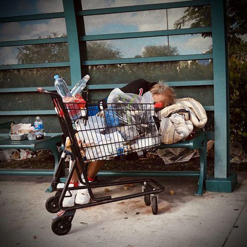 Side view of people sleeping on street