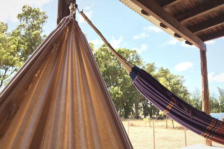 Descanso Life Is A Beach Lifestyles Free Relaxing Vacationtime Vacations Hammock Low Angle View Tree Day Curtain Sky No People Hanging Nature Outdoors