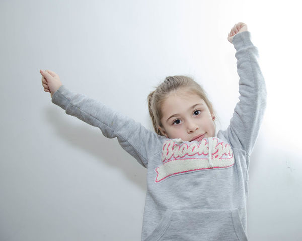 Adult Arms Raised Babies Only Baby Blond Hair Cheerful Childhood Confidence  Day Front View Fun Hand Raised Hands Up Hands Up In The Air Happiness Human Arm Human Body Part Human Limb Limb Looking At Camera One Person Outdoors People Portrait Smiling