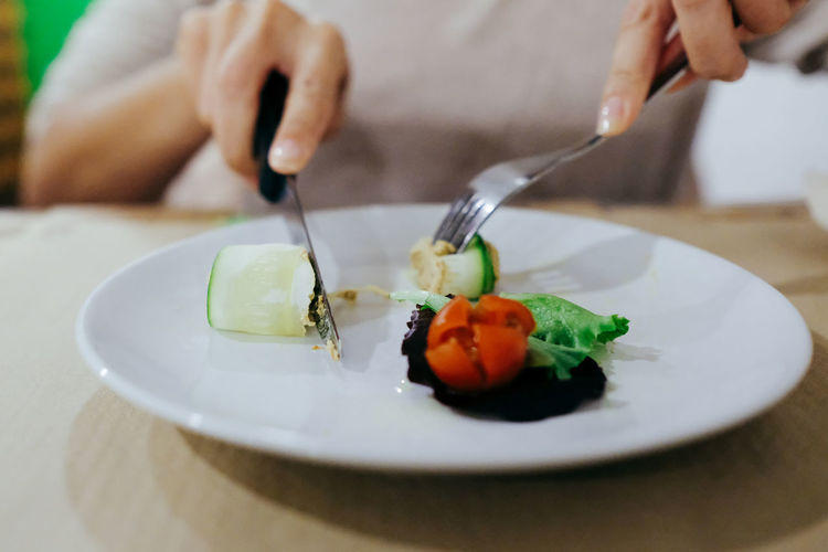 Close-up Cutting Day Food Food And Drink Fork Freshness Healthy Eating Holding Human Body Part Human Hand Indoors  Men One Person Plate Ready-to-eat Real People Serving Size Table Vegetable