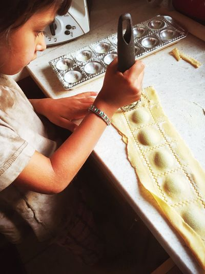 CHILD MAKING RAVIOLI
