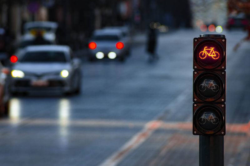 Traffic signal on road in city