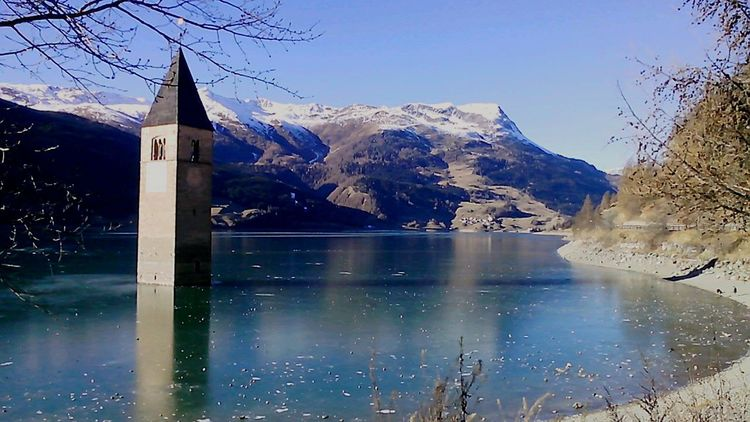 Resia Lake Resia Passo Resia Frozen Nature Nature Nature_collection Nature Lover Relaxing Taking Photos Enjoying Life Frozen Lake Hello World Lake Lake View Lakeside Clouds And Sky Mountains Mountain Mountain View Good Day Good Morning Peace And Quiet Beautiful Day Quality Time Enjoying The Sun