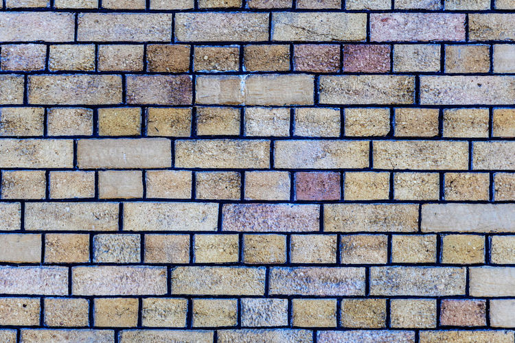 Close up of a brick-wall - Image No People Backgraund Wallpaper Pattern Texture Architecture Close-up Details Backgrounds Full Frame Textured  Brick Repetition Wall Wall - Building Feature Day In A Row Rough Bricks Building Template Copy Space Block Brickwork  Textured  Brown Material Solid Surface Weathered Backdrop Rock Masonry Cement Concrete House Construction Building Exterior Structure Stone Façade Modern Outside Rectangle Exterior