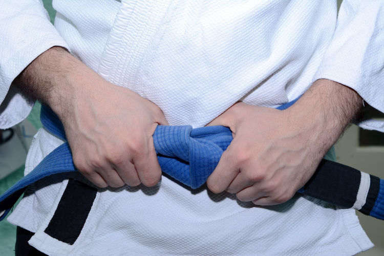 Close-up of person in martial arts uniform