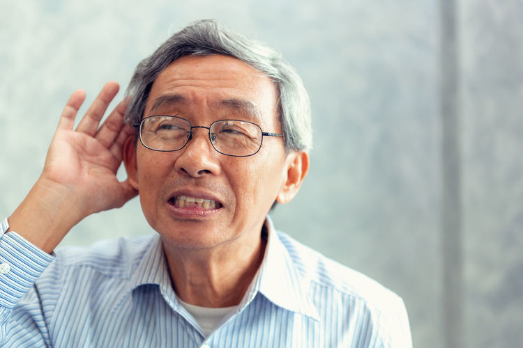 Portrait of senior man to trying hear something sound around him. Glasses Eyeglasses  One Person Front View Portrait Headshot Mature Adult Adult Gray Hair Senior Adult Real People Focus On Foreground Mature Men Lifestyles Indoors  Looking Men Males  Human Face Hairstyle Deafness Ears Trouble Hearing Difficult