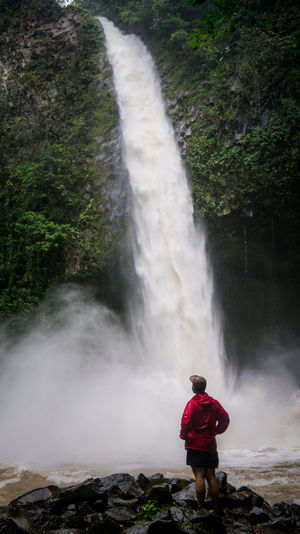 A man watches a water fall in La Fortuna, Costa Rica. Adult Adults Only Beauty In Nature Blurred Motion Costa Rica Day Fountain La Fortuna Long Exposure Motion Nature One Person One Woman Only One Young Woman Only Only Women Outdoors People Scenics Travel Destinations Watching Water Waterfall Young Adult