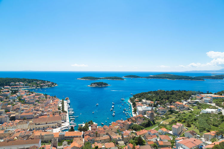 Aerial view at Hvar town's harbour on a sunny day in the Adriatic sea, Croatia Aerial Shot Croatia Hvar Hvar Croatia Hvar Island Adriatic Coast Adriatic Sea Aerial View Building Exterior Built Structure Croatian High Angle View Horizon Over Water Hvar Town Lifestyles Luxury Outdoors Sail Sailing Sea Sky Summer In Croatia Water Yacht Charter Yacht Charter Destination