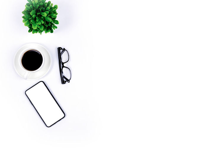 High angle view of coffee cup over white background